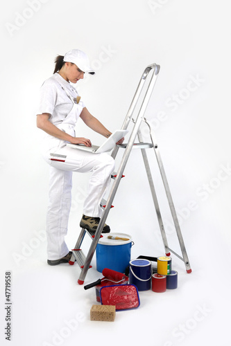 Female decorator using laptop computer