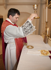 priest with the cap at tridentine mass - transfiguration