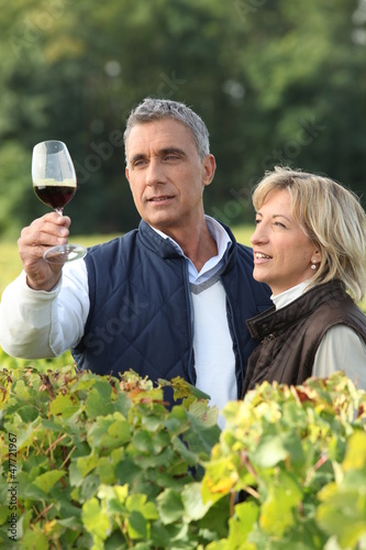 Winegrower with glass of wine