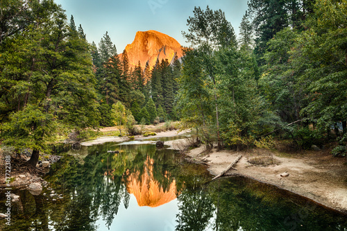 Half Dome reflect on Merced River, Yosemite Valley, USA