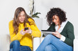 Two Women with Technological Devices
