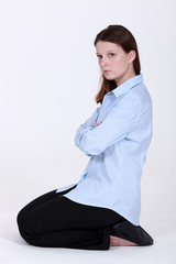 woman kneeling down cross-armed looking sulky