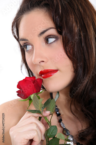 beautiful brunette with a red rose