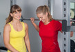 two happy women in a fitnes studio