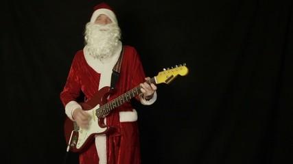 Santa Claus playing a guitar