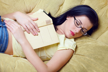 young woman fell asleep after reading book