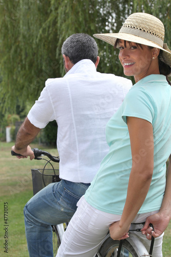 Man carrying woman on a bicycle