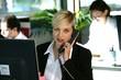 Busy blond office worker