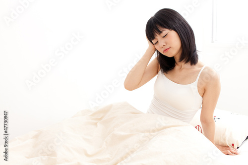 attractive asian woman in the bed