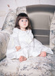 Baby dressed in white dress