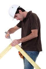 Makin making wooden frame
