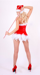back side of dancing Santa girl with candy cane stick on white