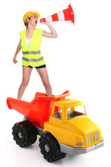 Female traffic guard yelling into a traffic cone
