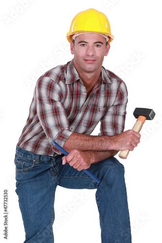 craftsman holding a huge hammer