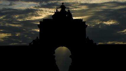 Portugal Arco da Rua Augusta sun passing
