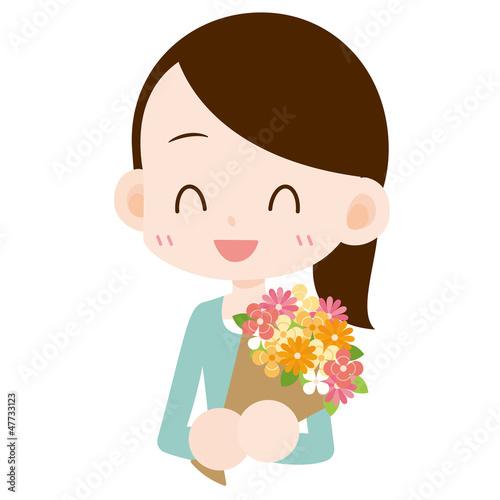 花束を抱える女性