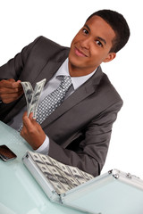 Businessman with a briefcase full of money