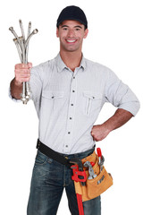 Man holding pipes