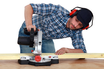 craftsman testing a new electric saw