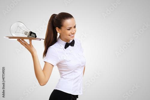 Waitress and bulb on th etray