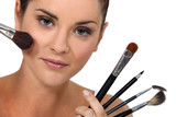 Woman posing with her make-up brushes
