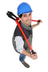 Tradesman holding large pliers