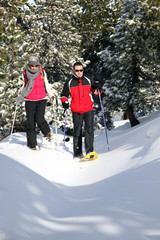 Couple walking in ski shoes