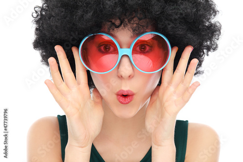 Woman with black afro and sunglasses