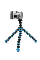 Camera on tripod isolated on white background