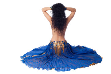 Rear view of a seated bellydancer in a blue costume
