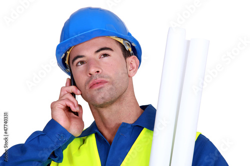 young blue collar on the phone