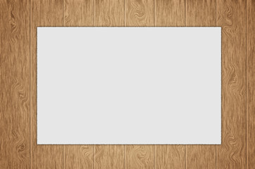 sheet of blank paper isolated on wood background
