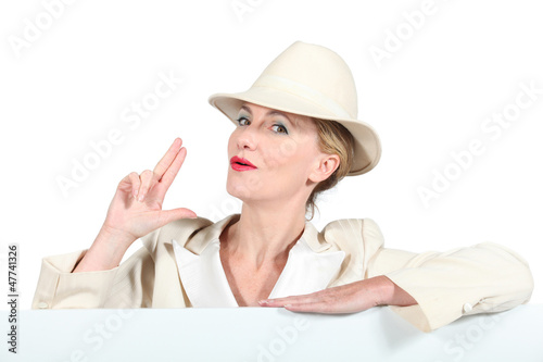 Blond woman in cream suite