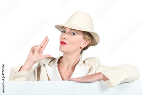 Blond woman in cream suite