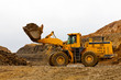 Yellow bulldozer in quarry