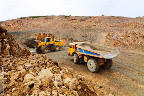 Truck and bulldozer work in quarry