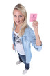 Blond teenage girl holding driving license