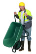 Man lifting a wheelbarrow