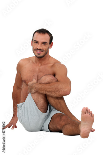 Man sat on the floor stretching