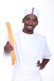 Baker holding a baguette
