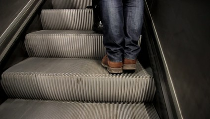 People walking in metro, escalator,
