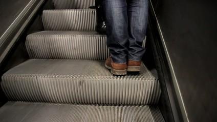 People walking in metro, escalator,