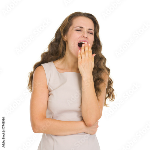 Young woman yawning