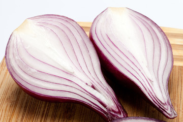 Red onions on a wooden board