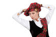 Woman dressed in traditional Scottish outfit with hands on head