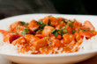 butter chicken sauce with rice and sliced carrots