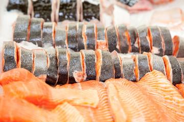 Salmon steak on ice.