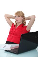 Blond woman taking a break from office duties