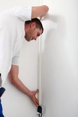 Man concealing wiring