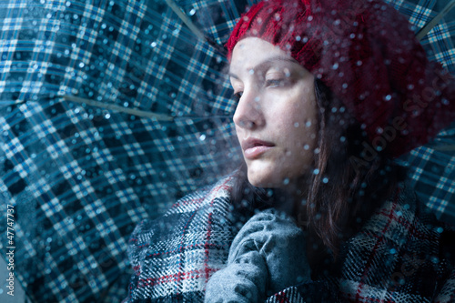 Sad Woman with Umbrella on a Rainy Day